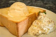 Honey toast is ice cream with whipped cream and bread topped. Honey toast is ice cream with whipped cream Royalty Free Stock Image