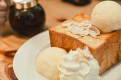 Honey toast with Icecream delicious tasty bread. Sweet dessert on wood table vintage color tone Royalty Free Stock Photo