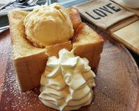 Honey toast with Icecream. And whipped cream Royalty Free Stock Images