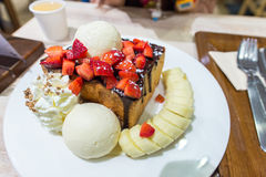 Honey toast with strawberries and bananas Royalty Free Stock Photo