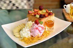 Honey toast with strawberry ice cream and honey syrup Royalty Free Stock Photos