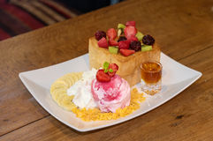 Honey toast with strawberry ice cream and honey syrup Royalty Free Stock Photo