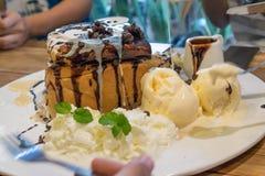 Honey toast with vanilla ice-cream and chocolate on plate Royalty Free Stock Photo
