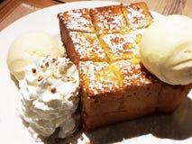 Honey toast with vanilla ice-cream Stock Photos