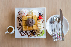Honey toast whipping cream with chocolate ice cream and spoon fork knife Royalty Free Stock Images