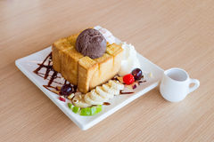 Honey toast and whipping cream with chocolate ice cream Royalty Free Stock Photography
