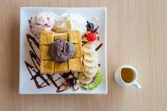 Honey toast and whipping cream with chocolate ice cream Stock Photos