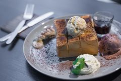 Honey Toast on a wooden table royalty free stock images