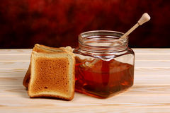 Honey and toasts Stock Photo