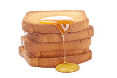 Honey on toasts Stock Photos