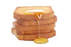 Honey on toasts Stock Photos