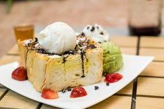 Honey toasts with strawberry, vanilla and green tea ice-cream Royalty Free Stock Photo