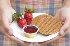 Honey waffles, jam and strawberry Royalty Free Stock Images