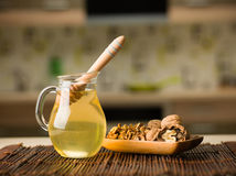Honey and wallnuts on kitchen table Stock Image