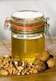 Honey with walnut 2. A honey with nuts on the table Stock Photo