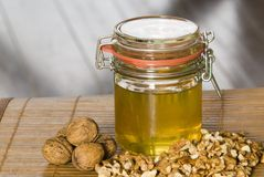 Honey with walnut. A honey with nuts on the table Stock Photo