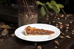 Honey and walnut tart with orange. royalty free stock photos