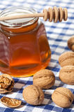Honey and walnuts Stock Images