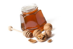Honey and walnuts Stock Photos