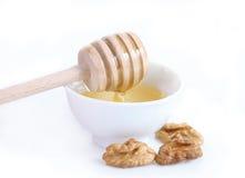 Honey and walnuts Royalty Free Stock Photography