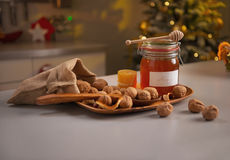 Honey and walnuts on table Royalty Free Stock Photo
