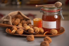 Honey and walnuts on table Royalty Free Stock Images