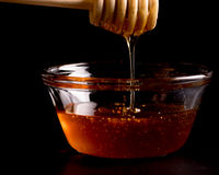 Honey and Wand in Glass Stock Photos