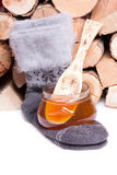 Honey and warm cotton socks Royalty Free Stock Photo
