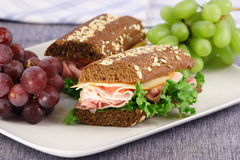 Honey wheat bread sandwich. Fresh sandwich made with organic selected ingredients Royalty Free Stock Images