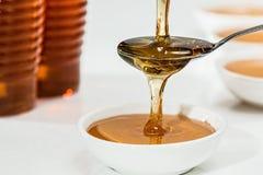 Honey on White Bowl Royalty Free Stock Image