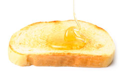 Honey on white bread Royalty Free Stock Image