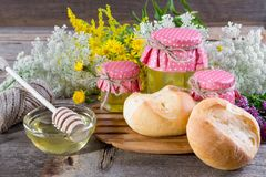 Honey and wild flowers, Fresh bread. On a rustic wooden background Royalty Free Stock Photo