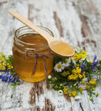 Honey and wild flowers Royalty Free Stock Photos