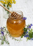 Honey and wild flowers Royalty Free Stock Photo