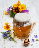 Honey and wild flowers Royalty Free Stock Images