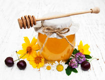 Honey and wild flowers Stock Image