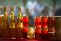 Honey and wine on a market stall. France royalty free stock photography