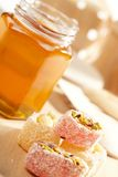 Honey with wood stick Stock Images