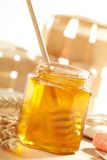 Honey with wood stick Stock Photos