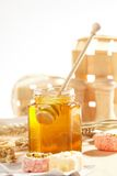 Honey with wood stick Stock Photography