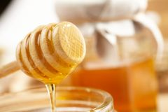 Honey with wood stick Royalty Free Stock Photo