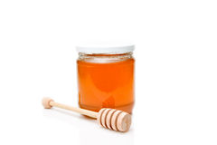 Honey with wood stick Royalty Free Stock Images