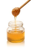 Honey with wood stick pouring. Stock Image