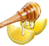 Honey with wood stick pouring onto a slice of lemon. Royalty Free Stock Photos