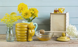 Honey on wooden background. Honey and flowers on wooden background royalty free stock photo