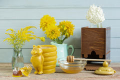 Honey on wooden background. Honey and flowers on wooden background stock photos