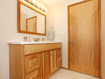 Honey wooden bathroom cabinets Royalty Free Stock Photo