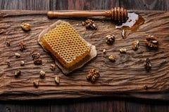 Honey on wooden board Stock Photos