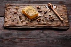 Honey on wooden board Royalty Free Stock Photo