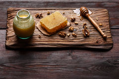Honey on wooden board Stock Images